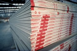Photo of a stack of wallboard in a warehouse