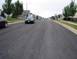 Photo of an asphalt-paved roadway